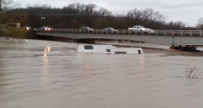Camper Floating Down River After Torrential Rains