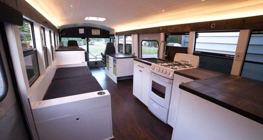 Couple School Bus Modern Motorhome Working
