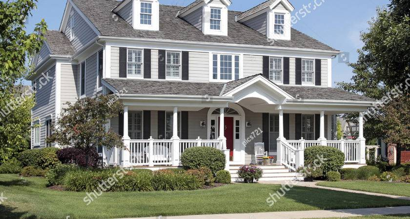 Large Suburban Home Front Porch Arched