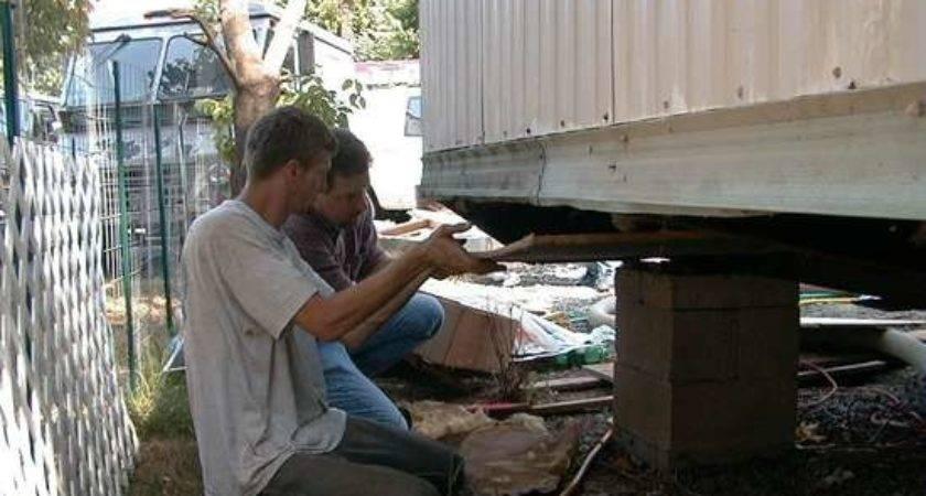 Virginia Weatherization Workers Inspecting Underbelly